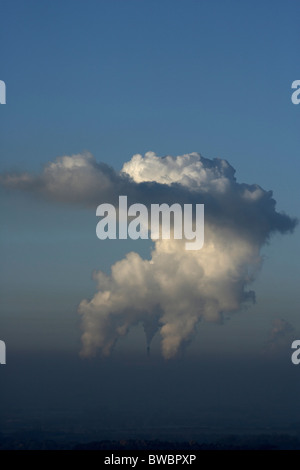 Giant steam clouds rising from the cooling towers at Drax coal fired power station, Selby, Yorkshire, UK. - Stock Photo
