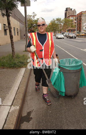 Boy George Court-Ordered Community Service Sweeping Streets for Department of Sanitation - Stock Photo