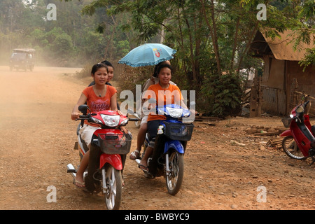 Teenage girls on a scooters, Ban Houayxay, Bokeo Province, Laos. - Stock Photo