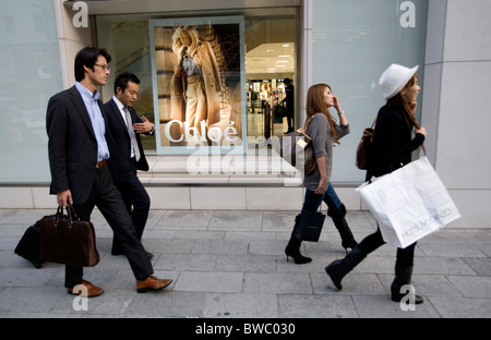 People walking in Ginza shopping Tokyo, Japan. - Stock Photo