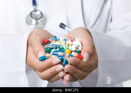 Close-up of vitamins and pills in human hands - Stock Photo