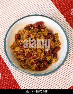 Food, Cooked, Meat, A bowl of Tex Mex chilli con carne with red kidney beans in a bowl on a table. - Stock Photo