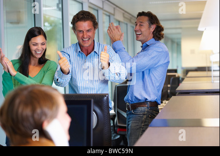 Business team closing a deal, happy - Stock Photo