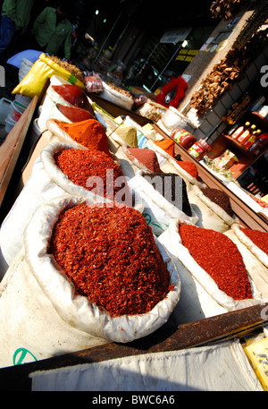 ISTANBUL, TURKEY. Bags of dried chilli flakes (pul biber) on a market stall in the Tahtakale district of the city. - Stock Photo