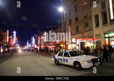 Police car on Granville Street at night, Vancouver, British Columbia, Canada - Stock Photo