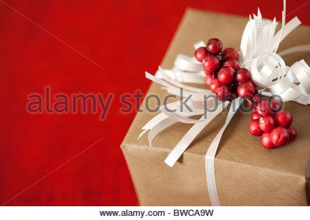 USA, California, La Quinta, Christmas present on red background - Stock Photo