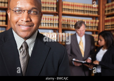 USA, California, Oakland, Business people in library, focus on man - Stock Photo