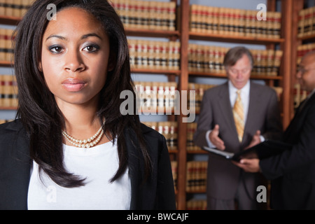 USA, California, Oakland, Business people in library, focus on woman - Stock Photo
