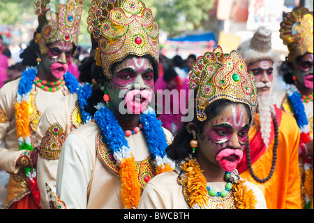 Indian festival street performers dressed as Hanuman, at Sathya Sai Baba 85th birthday celebrations in Puttaparthi, - Stock Photo