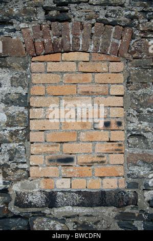 a bricked up window, uk - Stock Photo