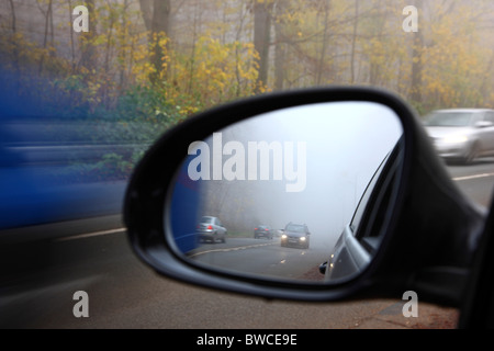 Autumn, thick fog, low visibility on a road. Essen, Germany. - Stock Photo