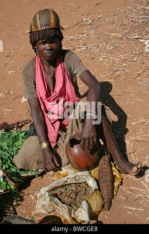 Bena Tribewoman Selling Cheweing Tobacco At The Key Afer Market, Omo Valley, Ethiopia - Stock Photo