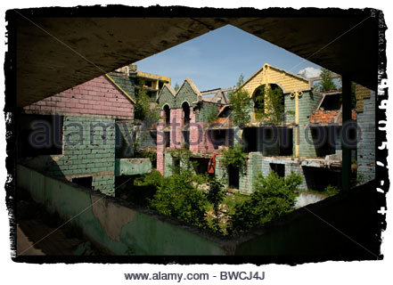 Exterior of a house shows shrapnel damage from the 1992-95 war in downtown Sarajevo, Bosnia Herzegovina - Stock Photo