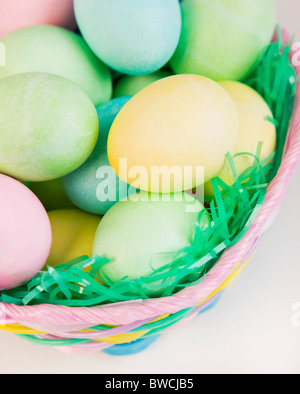 Studio shot of Easter eggs in basket - Stock Photo