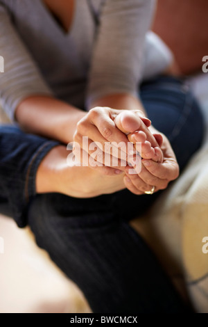 Woman massaging foot - Stock Photo