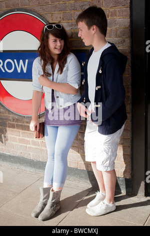 A young teenage boy and girl during their Easter school holidays waiting for a London Underground tube train. DAVID - Stock Photo
