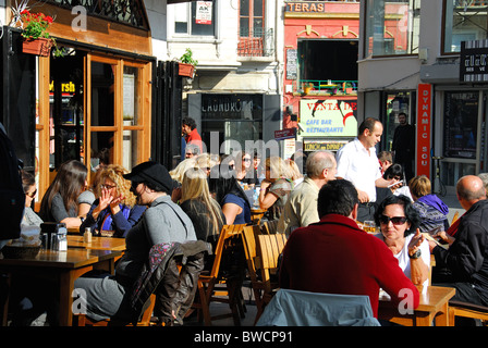ISTANBUL, TURKEY. People eating outside a restaurant in the Galata district of Beyoglu. 2010. - Stock Photo
