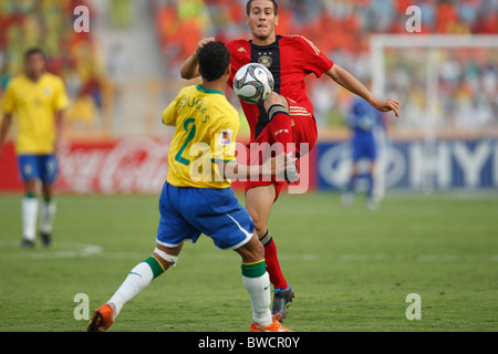 Mario Vrancic of Germany (r) stretches for the ball against Douglas of Brazil (l) during a 2009 FIFA U-20 World - Stock Photo
