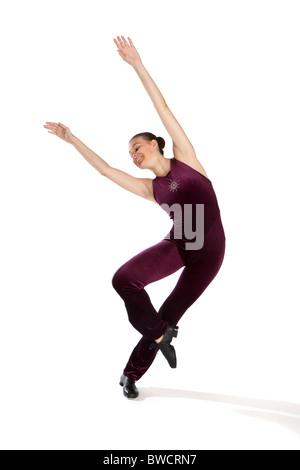 Studio shot of beautiful young girl in tap dancing costume - Stock Photo