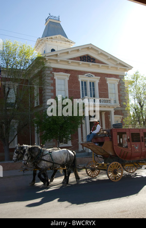 Stagecoach in front of Tombstone Courthouse State Historic Park in old mining town of Tombstone, Arizona - Stock Photo