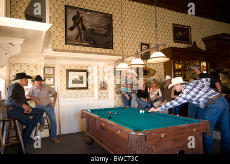 Shooting pool at the Crystal Palace Saloon in old mining town of Tombstone, a national historic landmark district - Stock Photo