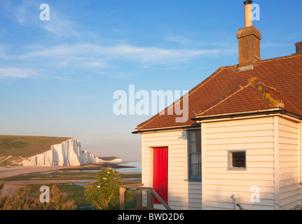 Coast Guard cottages at sunset; Seven Sisters; East Sussex; England, Great Britain - Stock Photo