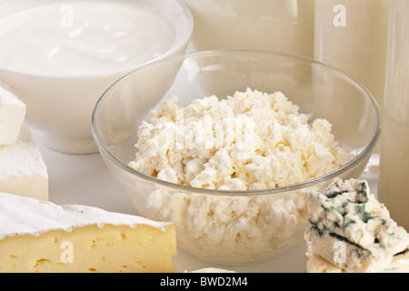 Different milk products: cheese; cream; milk. On a white background. - Stock Photo