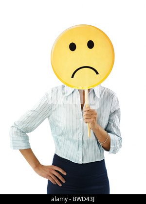 businesswoman holding emoticon - Stock Photo