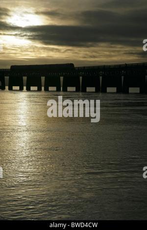 Train crossing the Tay Bridge, Dundee, Scotland. - Stock Photo