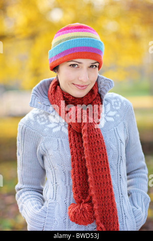 A beautiful young woman in autumn park - Stock Photo