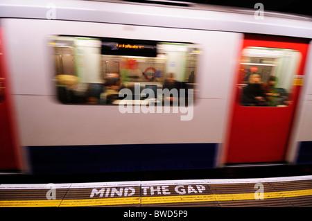 Mind the Gap safety warning notice at Monument Underground Tube Station, London, England, UK - Stock Photo