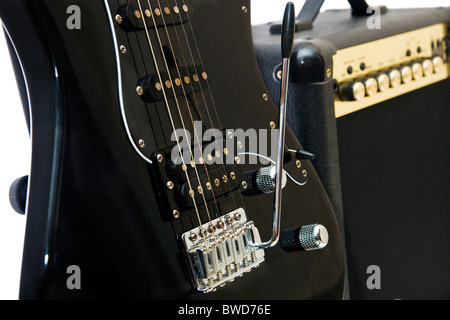 Electric guitar and amplifier isolated on a white background - Stock Photo