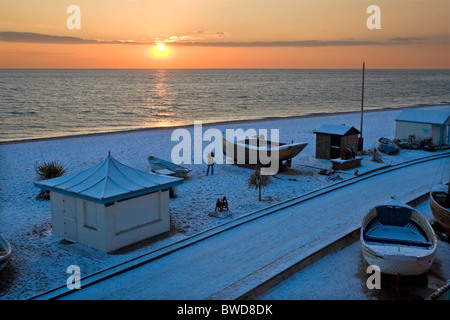 Boats on snow covered beach at sunset. Brighton, UK JPH0269 - Stock Photo
