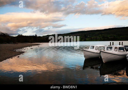 Small pleasure boats moored for the night at Coniston Water, Lake District, Cumbria UK - Stock Photo