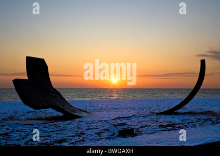 Silhouette of Passacaglia sculpture on snow covered beach during sunset. Brighton, UK JPH0271