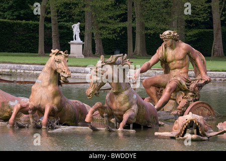 the apollo fountain depicts the sun god rising out of the water on a chariot, château de versailles - Stock Photo