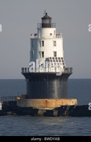 The Harbor of Refuge Light located on the Delaware Breakwater in Delaware Bay, decorated with wreaths for the holiday - Stock Photo