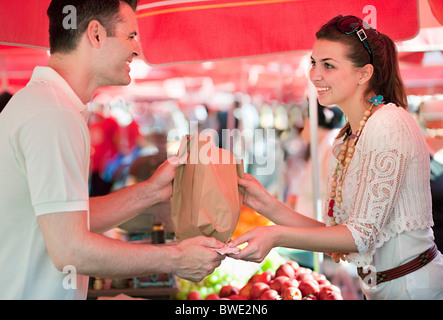 Young woman shopping for fruit - Stock Photo