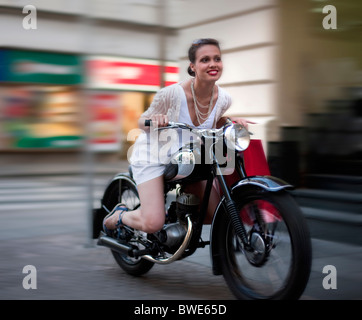 Young woman riding motorcycle - Stock Photo