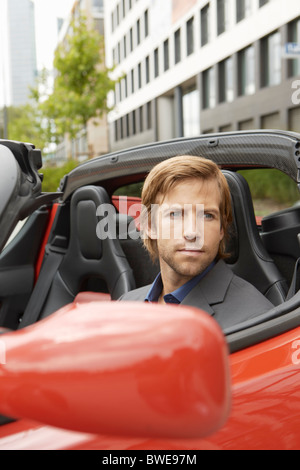 Business man in electric sports car - Stock Photo