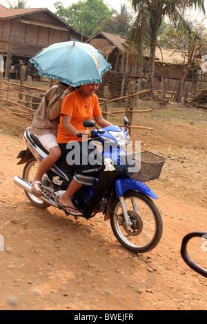 Teenage girls on a scooter, Ban Houayxay, Bokeo Province, Laos. - Stock Photo