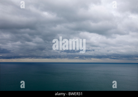 A heavy sky over the sea at Aberystwyth, Wales, UK - Stock Photo