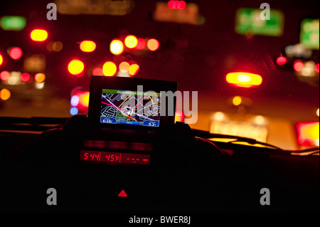 GPS unit in the window of a car in traffic. - Stock Photo