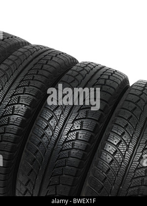 Set of four winter tires isolated on white background - Stock Photo