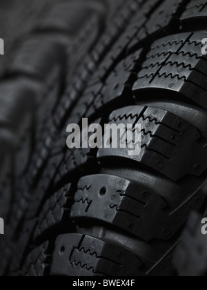 Closeup of a winter car tire tread - Stock Photo