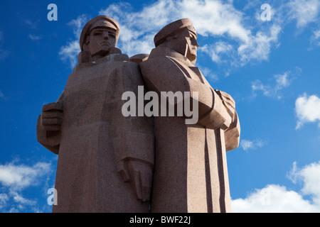 Latvian Red Riflemen Monument (Strelnieku piemineklis) in old town, Riga. Latvia - Stock Photo