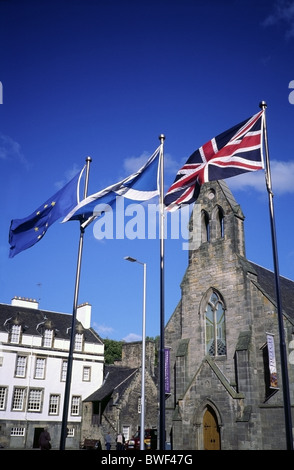 Flags Flying in Holyrood outside the Parliament building looking towards The Queens Gallery, Edinburgh, Scotland - Stock Photo