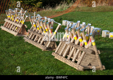 fireworks arranged ready for an organised commercial firework display on bonfire night in november in england - Stock Photo