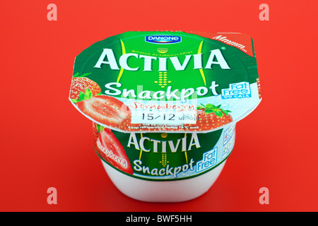 Tub of Strawberry flavoured Activia by Danone - Stock Photo