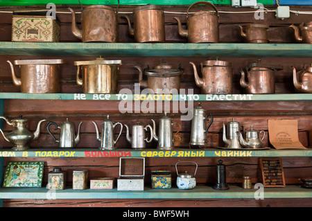 Antique teapots on shelves - Stock Photo